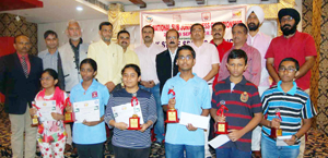 Winners posing for a group photograph alongwith chief guest and other dignitaries during concluding function of Sub Junior National Chess C'ship in Jammu on Tuesday.