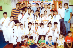 Medal winners of 1st District Hapkido Championship posing for a photograph along with dignitaries at Baby Caterers, Rehari in Jammu on Saturday.
