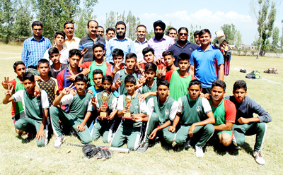 Winners of Softball Championship posing for a group photograph along with the dignitaries at Pulwama on Wednesday.