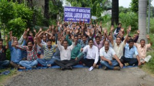 Casual labours of Agriculture Department during a protest dharna at Krishi Bhawan Talab Tillo, Jammu.