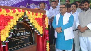 DyCM Dr Nirmal Singh inaugurating bridge during his tour to Billawar on Monday.