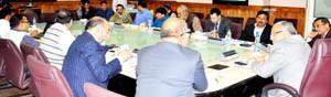 Chief Secretary, BR Sharma chairing a meeting at Srinagar on Wednesday.