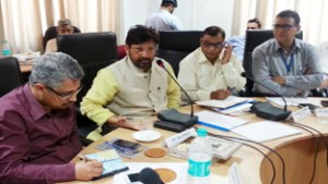 Minister for Health, Ch Lal Singh chairing a meeting at Jammu on Thursday.