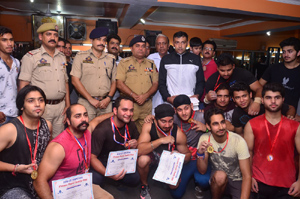 Medal winners of Dead Lift Championship posing for a group photograph alongwith dignitaries in Jammu.