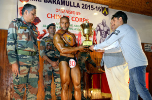 Winner of Body Building Competition conducted by Army being felicitated in Baramulla on Thursday. —Excelsior/Aabid Nabi