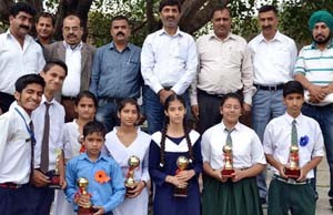 Winners of painting competition posing for a group photograph.