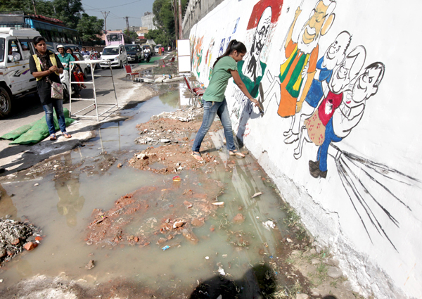 'Swachh Bharat Abhiyan' launched amidst heaps of garbage outside GMC Bakshi Nagar on Friday. -Excelsior/Rakesh