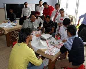 Team of doctors examining journalists during a Dental Check-up camp at Press Club Jammu on Tuesday.