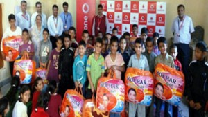 Beneficiaries posing for photograph during woollen donation camp organised by Vodafone at Balgram.