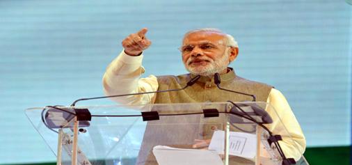 Prime Minister, Narendra Modi addressing the Indian diaspora in Kuala Lumpur, Malaysia on Sunday. (UNI)