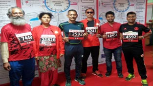 Athletes posing for a group photograph before their participation in Delhi Airtel Half Marathon.