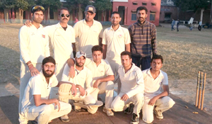 Players of Singh Cricket Club Akhnoor posing for a group photograph after clinching victory.