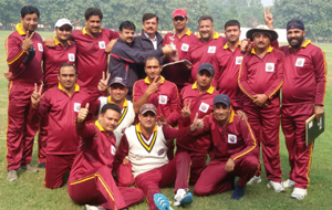 JU Employees Cricket team posing for a group photograph alongwith manager Sunil Sahi after registering a win over Pune University at Gorakhpur on Tuesday.