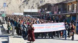 State Govt employees taking out protest march in Leh town on Tuesday. -Excelsior/ Stenzin