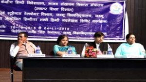 Principal Commissioner Income Tax Sangeeta Gupta and others on dais during valedictory function of Hindi writers camp at JU on Wednesday.
