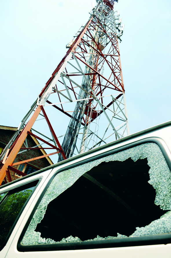 1-June-2015- SRINAGAR: A vehicle was damaged after militants fired a rifle grenade towards an Airtel tower at Habba Kadal in old Srinagar city, on Monday. This is the first such incident of this kind in the heart of the city as militants have carried out at least half a dozen attacks on mobile towers in other parts of the Valley especially North Kashmir and a employee of Airtel was also injured. Photo/Mohd Amin War