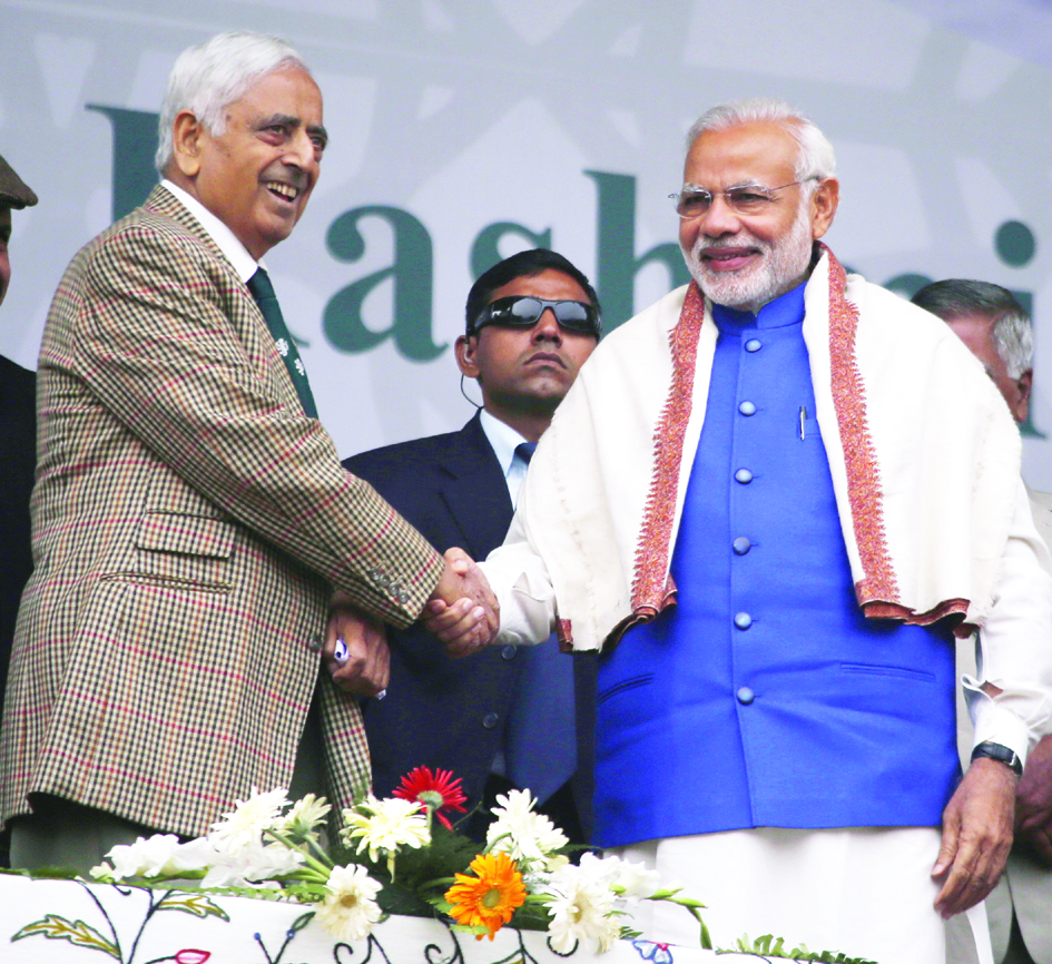 November - 7, 2015- SRINAGAR Prime Minister Narendra Modi shaking hands with Jammu and Kashmir Chief Minister Mufti Muhammmad Sayeed during a mammoth public rally in Sher-e-Kashmir Cricket Stadium in Srinagar on Saturday that was addressed by the PM. Photo/Mohd Amin War