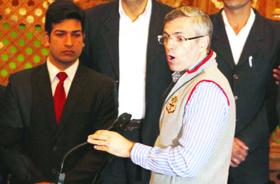 October-8,2015-SRINAGAR : Principle opposition party National Conference leader and legislator Omar Abdullah speaking in Lower House of Assembly after assault on Independent Lawmaker Engineer Abdul Rashid by BJP legislators inside the House today before the business began, in Srinagar on Thursday. Photo/Mohd Amin War