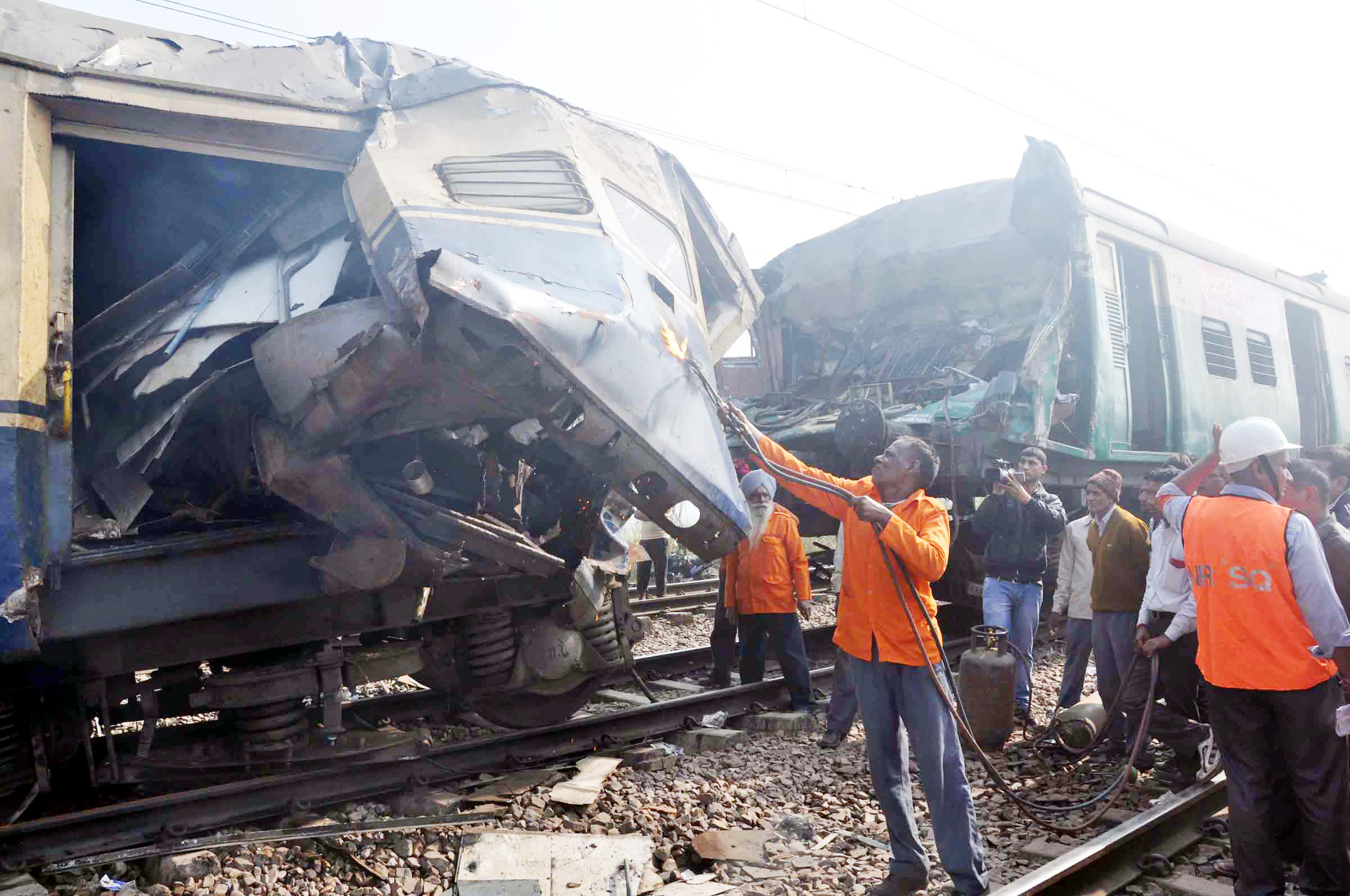 Railway officials engaged in removing damaged coaches of Lokmanya Tilak Express and EMU train which collided in Haryana's Palwal district on Tuesday morning, at least one person killed and over 100 injured in the accident.(UNI)