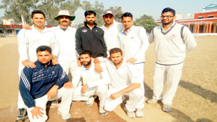 Players of Singh CC Akhnoor posing for a group photograph after registering a win over Vijayanta Club on Sunday.