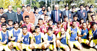 Governor N N Vohra posing along with players for a group photograph during Silver Rolling Volleyball championship.