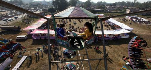Girls enjoy 'Jhoola' during Red Cross Mela at Govt College for Women, Gandhi Nagar on Sunday. —Excelsior/Rakesh