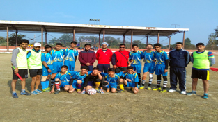 Young footballers posing along with officials during SSPF Talent Search Tournament.