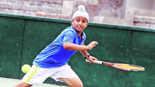 Sumitpal in action while playing a forehand shot during a pre-quarterfinal match of AITA Tournament in Chandigarh.
