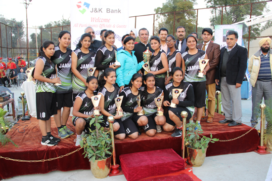 Winners of Sr State Basketball Championship posing for a group photograph alongwith Prof Amitabh Mattoo, Advisor to Chief Minister at MA Stadium in Jammu.