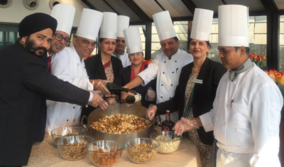 Staff of KC Residency during a cake mixing ceremony on Thursday.