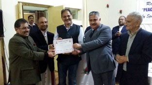 Guests honouring members during Inter-Religious Meet at Jammu on Saturday.