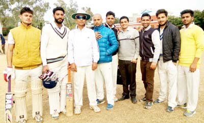 Singh Cricket Club players posing for a group photograph after clinching victory at Akhnoor on Thursday.