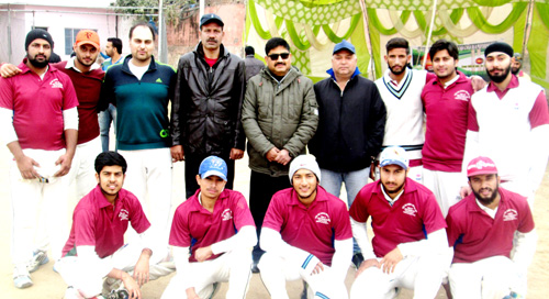 Winners posing alongwith dignitaries and officials during a match of 4th Eid-Diwali-Christmas Cup at Parade Ground in Jammu.