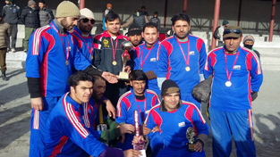 Winners of 7th District Tennis Ball Cricket Championship posing for a group at Kargil on Friday.