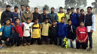 Selected players for Jammu Football Academy posing for a group photograph alongwith dignitaries and officials in Jammu.