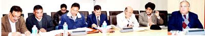 Chief Secretary B.R Sharma chairing a meeting at Jammu on Monday.
