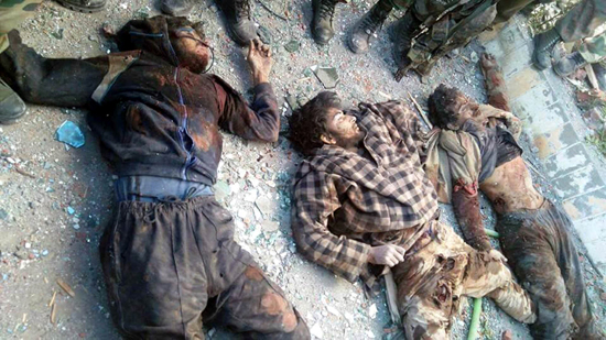 Bodies of three militants who were holed up inside the EDI building at Pampore in South Kashmir's district of Pulwama on Monday. (UNI)