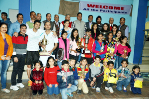 Winners posing for a group photograph alongwith dignitaries during valedictory function of 42nd J&K State Badminton Championship at Police Lines Badminton Hall in Jammu.