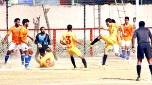 A superb attempt being made by the players in scoring a goal during a Santosh Trophy match at GGM Science College Football ground in Jammu on Monday.