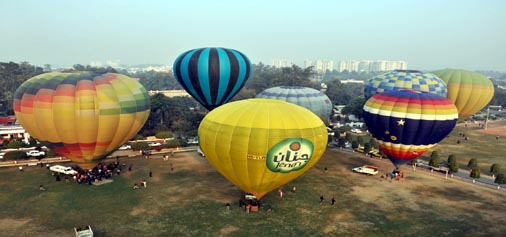 People enjoying in the hot air balloon in Lucknow on Wednesday. (UNI)