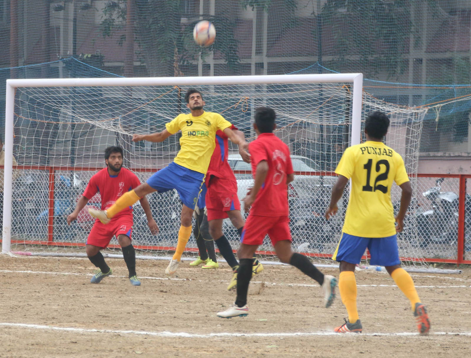 Footballers in a tough fight while trying to get hold of the ball during a Santosh Trophy match at GGM Science College ground on Thursday. -Excelsior/Rakesh