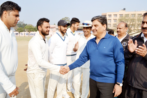 Mehboob Iqbal interacting with players after inaugurating Cricket Tourney 'Salute & Tribute to Siachen Martyrs' at Parade Cricket Ground in Jammu on Sunday.