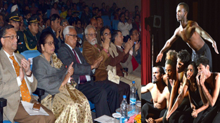 Governor N N Vohra and others witnessing a performance on inaugural of international theatre festival.