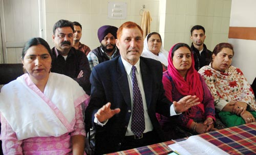 NTUF president Gafoor Dar and Anganwadi workers' leaders Ratna Devi and Hanifa addressing joint press conference in Jammu on Monday.
