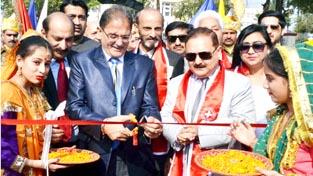 Speaker Legislative Assembly, Kavinder Gupta flanked by Divisional Commissioner, Dr Pawan Kotwal inaugurating Red Cross Mela in Jammu on Saturday.