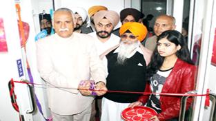 Rajya Sabha MP, Shamsher Singh Manhas, accompanied by MLC Charanjeet Singh Khalsa inaugurating 'Medi-Aid Pharmacy' at Rehari Chungi in Jammu.