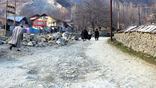 Drangbal road in North Kashmir's Baramulla district in shambles.     -Excelsior/ Aabid Nabi
