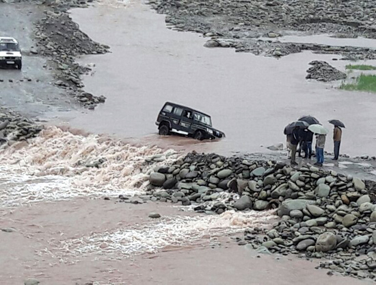 A vehicle trapped in Poonch river after bailey bridge was washed away in floods on Thursday morning. Another pic on page 6. —Excelsior/Harbhajan