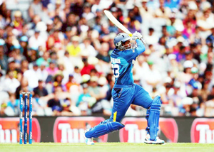 Tillakaratne Dilshan hitting a big shot during his knock of 83 runs against Afghanistan in World Cup T-20 on Thursday.