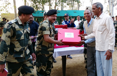 Officers of 9 Bn BSF presenting stationery items to Govt High school, Chaksadda in border belt of Samba District.